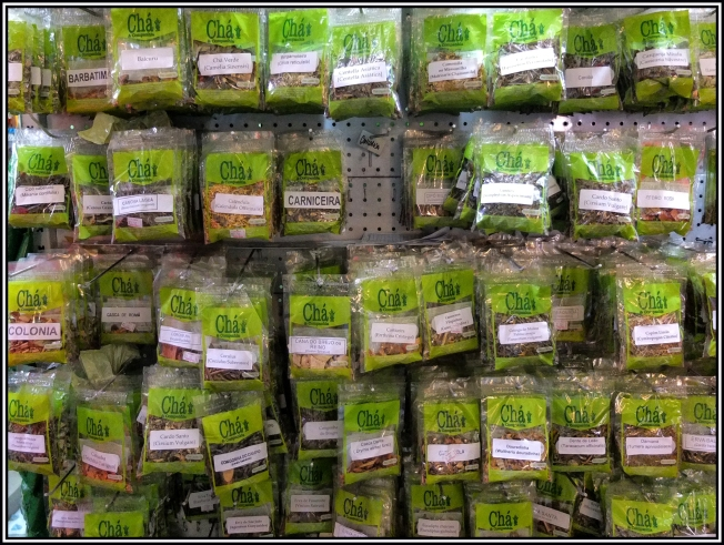 In the Mercado Publico (Public Market) in Porto Alegre, Brazil, teas are sold in small packages. They are called Chá, here the teas are labelled with the common name and some with the scientific name too.