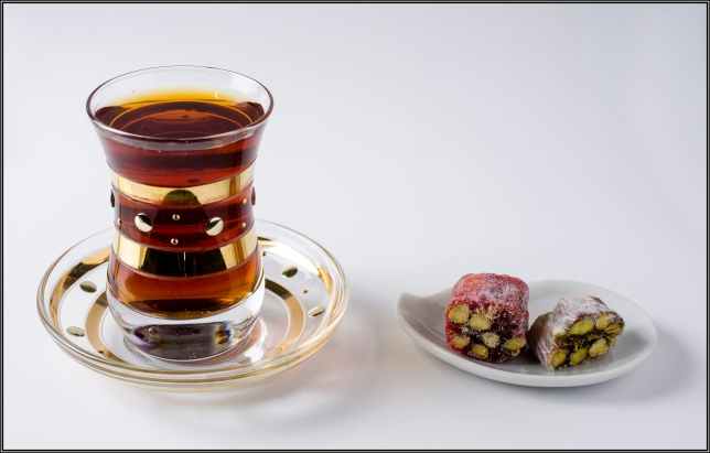 Freshly brewed tea in the gold painted tulip. On the right the Tukish Delights to complement the tea. One pomegranate-pistachio  another mastiqe-pistachio. Magnificent.
